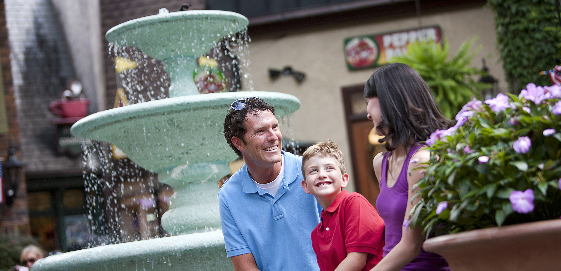 A Family near the Village Fountain | Gatlinburg Attractions | Things To Do In Gatlinburg, TN